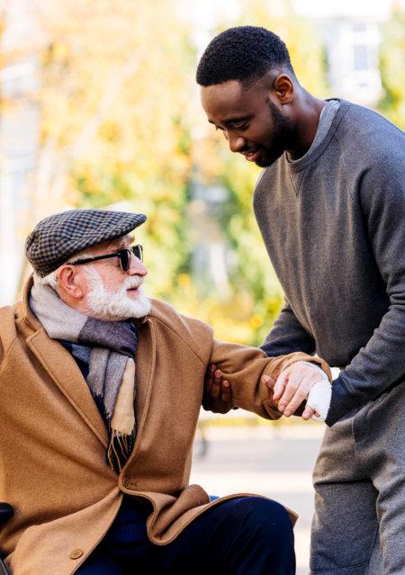 a man helping the senior man