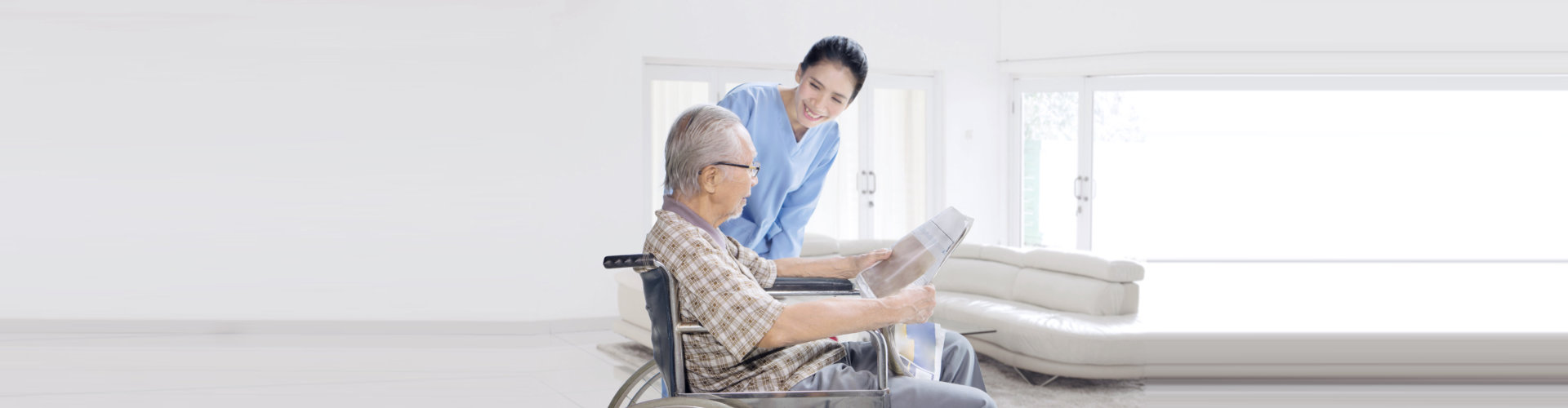 lady caregiver talking with the man on the wheelchair